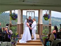 Ralph Fishburn, of Ralph's Regal Weddings performing a wedding ceremony for a same-sex couple at Bliss Hill Event Center, Chattaroy, Washington.