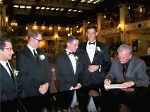 Ralph Fishburn, of Ralph's Regal Weddings, performing wedding fora same-sex couple at The Davenport Hotel, Spokane, Washington.