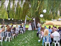 Ralph Fishburn, of Ralph's Regal Weddings, performing wedding ata private home, Spokane Valley, Washington.